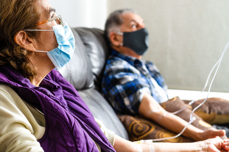 Senior couple wearing mask at hospital
