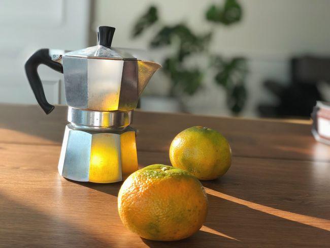 Shining moka pot Still Life Coffee - Drink Orange Orange Color Shine Moka Pot No People Indoors  Wellbeing Freshness Close-up Drink Yellow Citrus Fruit Container Sunlight Household Equipment