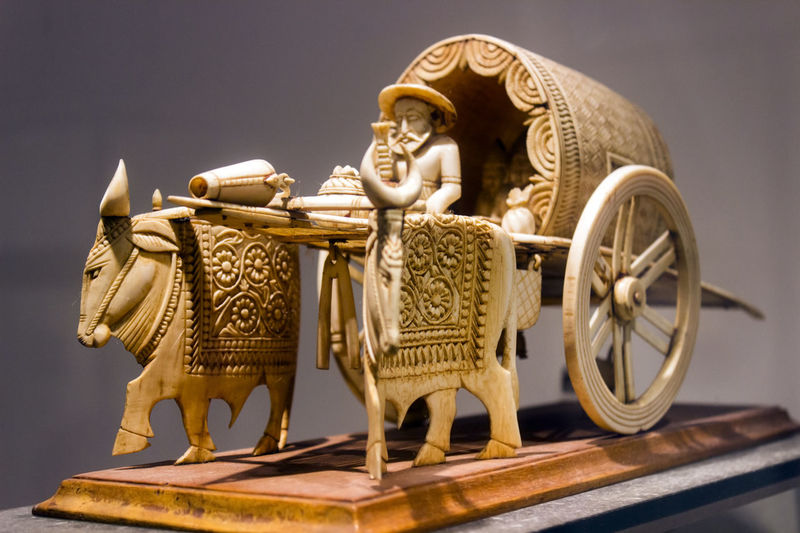 ox cart, miniature, indian museum, kolkata, india. Indian Museum Kolkata Miniatures Muesum Wheel Architecture Cart Wheels Carving - Craft Product Close-up Cow Day Design Gold Gold Colored Historical History Indian Museum Kolkata ,india Indoors  Marble Miniature No People Ox Cart Sculpture Statue