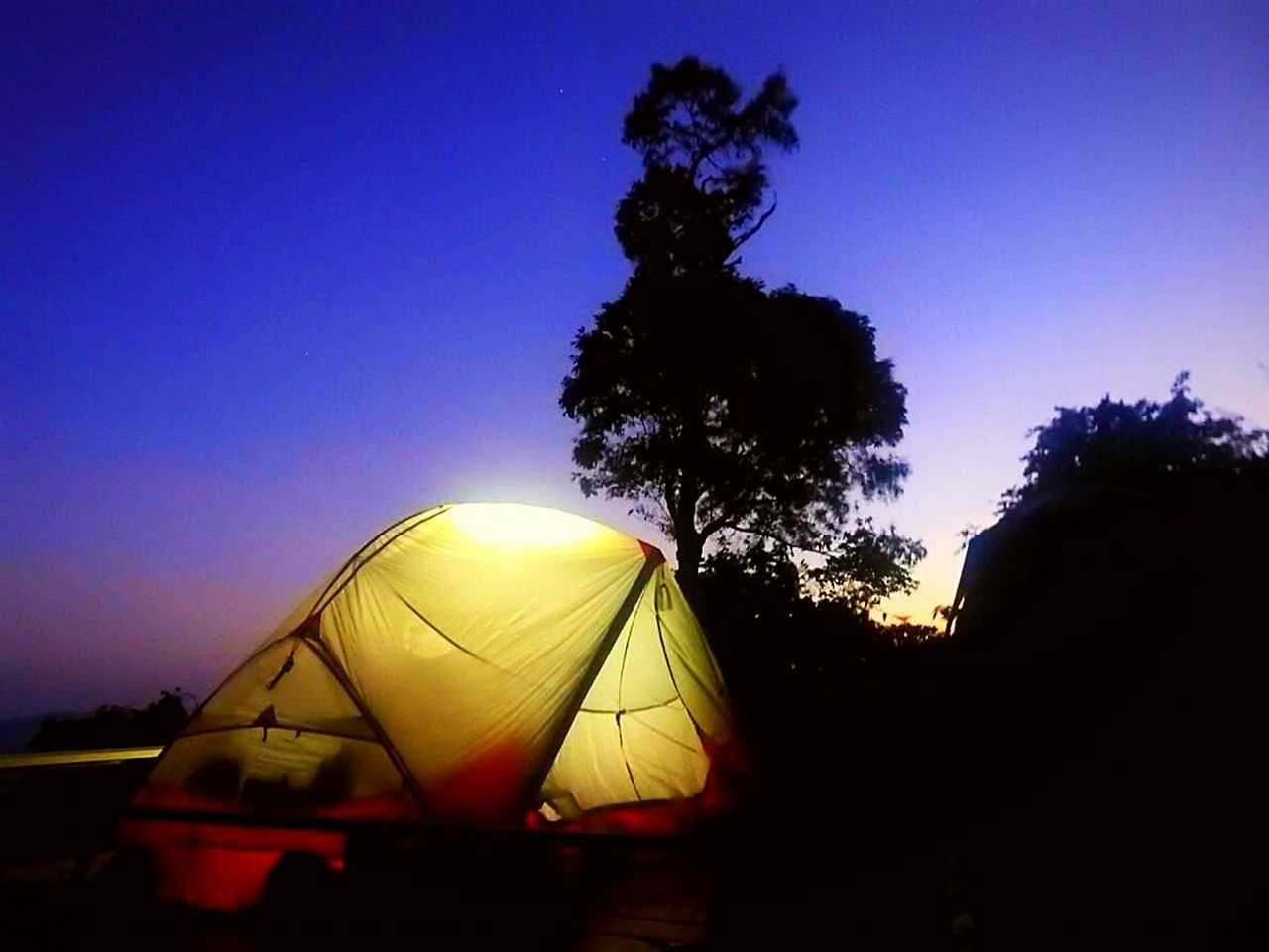 sky, tree, plant, silhouette, sunset, tent, nature, transportation, mode of transportation, clear sky, no people, sunlight, camping, blue, outdoors, growth, copy space, scenics - nature, sun, beauty in nature
