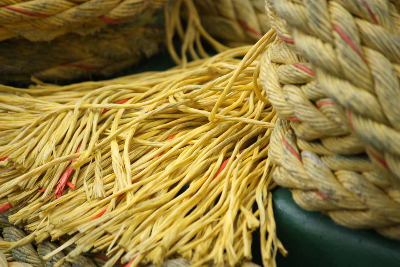 rope, close-up, no people, still life, day, strength, tied up, focus on foreground, abundance, high angle view, outdoors, large group of objects, food and drink, yellow, pattern, food, heap, rod, freshness, nature, tangled