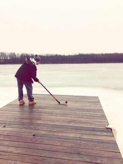 TestingTheIce Slapshot Ice Hockey Ice Hockey Stick Puck Pond Pond Hockey Hockey Hockey Water Athlete Paddleboarding Men Full Length Lake Sports Clothing Senior Adult Activity Standing