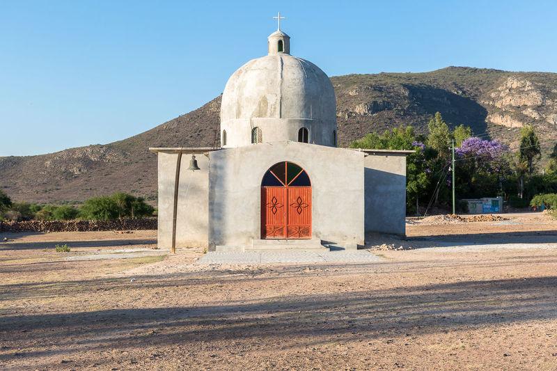 Church On Field Against Mountain