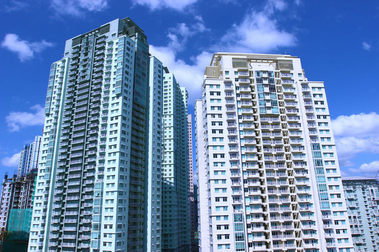 Architecture Blue Building Building Exterior Built Structure City Cloud Day Low Angle View Modern Outdoors Sky Skyscraper Tall - High Tower Wide Angle SM Aura Taguig Philippines