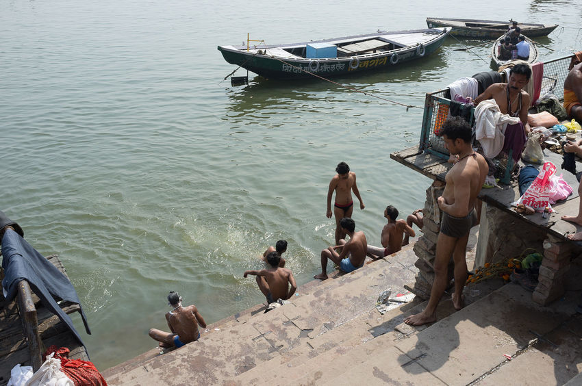 Bathing men on the ghats of the Ganges River in Varanasi Bathers Bathing Benares Boat Day Ganges Ganges River Ghats  Ghats Of Varanasi Ghats On The Ganges High Angle View Large Group Of People Men Nautical Vessel Outdoors People Real People River Riverside Washing Water