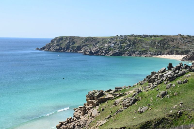 Coastal Life Sea Nature Rock Formation Scenics Beauty In Nature Clear Sky Horizon Over Water Cliff Tranquility Water Day Sky Beach Outdoors Rocky Coastline Blue Landscape_photography EyeEm Best Shots NIKON D5300 Nikonphotography Seascape Views Reality Waterfront view to Porthcurno Beach