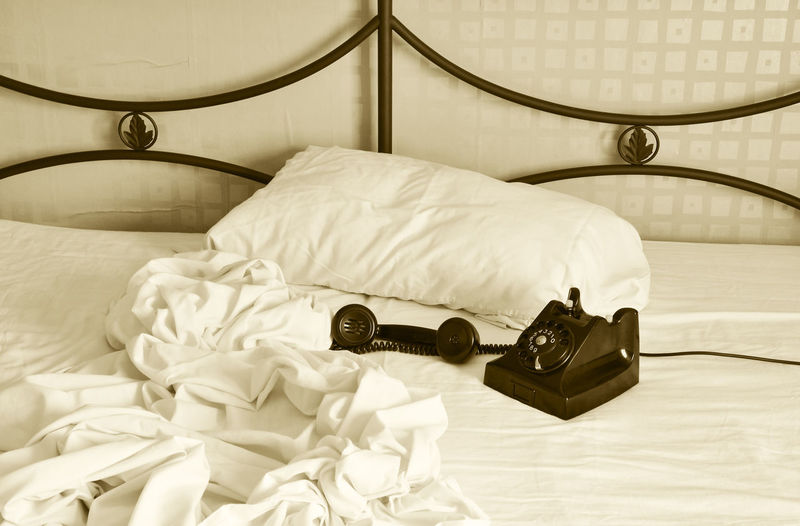 Unmade bed and retro phone Emergency Retro URGENT Bed Bedroom Close-up Consept Day Home Interior Home Showcase Interior Indoors  No People Old-fashioned Phone Call Pillow Sepia Sheet Telephone Unmade Bed #urbanana: The Urban Playground A New Beginning
