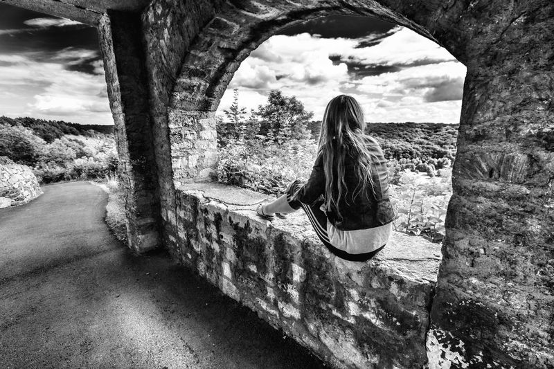 EyEmNewHere Thüringen Germany Jena Fuchsturm Long Hair One Person Real People Tree Leisure Activity Rear View Lifestyles Day Nature Cloud - Sky Young Women Sitting Full Length Outdoors Sky Women Architecture Adult Adults Only EyeEmNewHere Black And White Friday