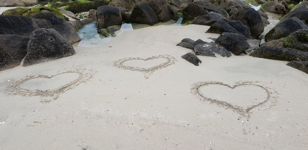 Hearts in the sand EyeEmNewHere Loveletters In The Sand Beach Sand Close-up Shore Heart Shape I Love You Sandy Beach