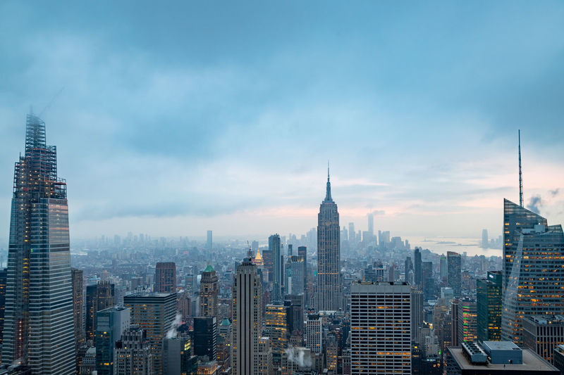New york skyline from the top of the rock with clouds in sky