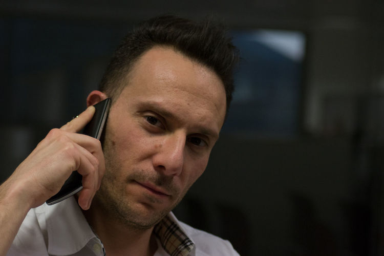Portrait Of Man Talking On Mobile Phone