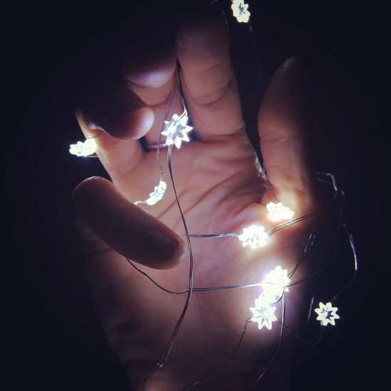 Stars IPhoneography Christmastime Christmas Lights Illuminated Light And Shadow Light Human Finger Human Body Part Holding Indoors  One Person Close-up