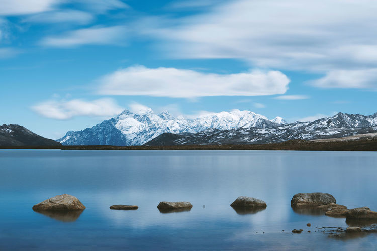 Blue sky, white clouds, snowy mountains, lake China Landscape Mountain Sky Cloud - Sky Beauty In Nature Nature Scenics - Nature Travel Destinations Travel Water Lake Reflection Day Cold Temperature Environment Snowcapped Mountain Rock Stone Waterfront Tranquil Scene Snow Mountain Peak