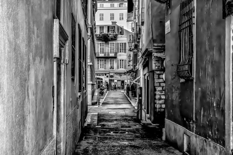 On the streets in the old town of Nice, France Architecture Built Structure Direction The Way Forward Building Building Exterior City Narrow Diminishing Perspective Residential District Alley Outdoors Footpath Street Empty In A Row Long Blackandwhite Black And White Black & White France Nice France Vieux-nice EyeEm Best Shots Historic Cobblestone Exterior One Way Walkway Residential Structure