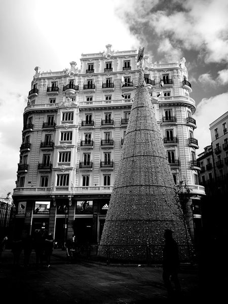 Travel Experiences Christmas Madrid Madrid Spain SPAIN Blancoynegro B&w B&w Street Photography Gran Via, Madrid Gran Vía Street Navidad Christmas Tree Arbol De Navidad Architecture Built Structure Low Angle View Building Exterior Sky Cloud - Sky Travel