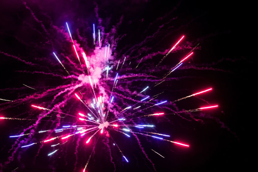 Exploding in Air Multi Colored Arts Culture And Entertainment Firework Display Celebration Firework - Man Made Object Event Exploding Illuminated Sky Entertainment Sparks Blurred Motion Smoke - Physical Structure Emitting Firework Light Painting Glowing Light Trail Sparkler Magenta
