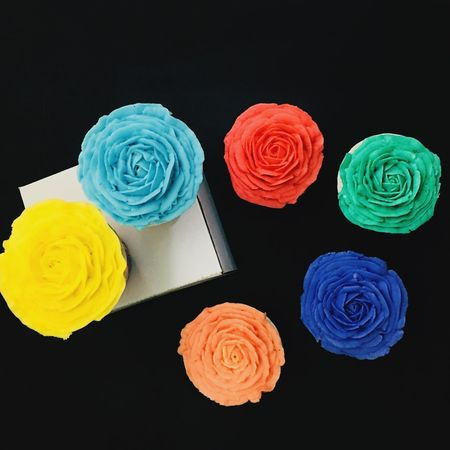 Flower Cupcakes Buttercream Rose Cupcakes Sweet Food Multi Colored Blue Indoors  Food Temptation No People Dessert Flower Black Background Studio Shot Freshness Close-up