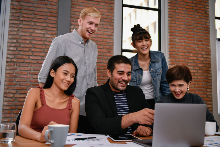 Business concept. Businessmen are working together as a team. Business people are brainstorming together. Express Ideas Advise ARCHITECT Asian  Assemble Background Board Business Businessman Businesswoman Casual Business Caucasian Colleague Consult Conversation Counsel Coworker Dealing Designer  Discussing Document European  Explaining  Guide Happiness Happy Lifestyle Man Manager Market Meeting Office Partner People Personal Present Professional Recommend Relax Relaxation Smiling Suggest Talking Team Teamwork Togetherness Woman Work Worker Young Adult