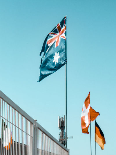 Low angle view of flags flag against clear sky