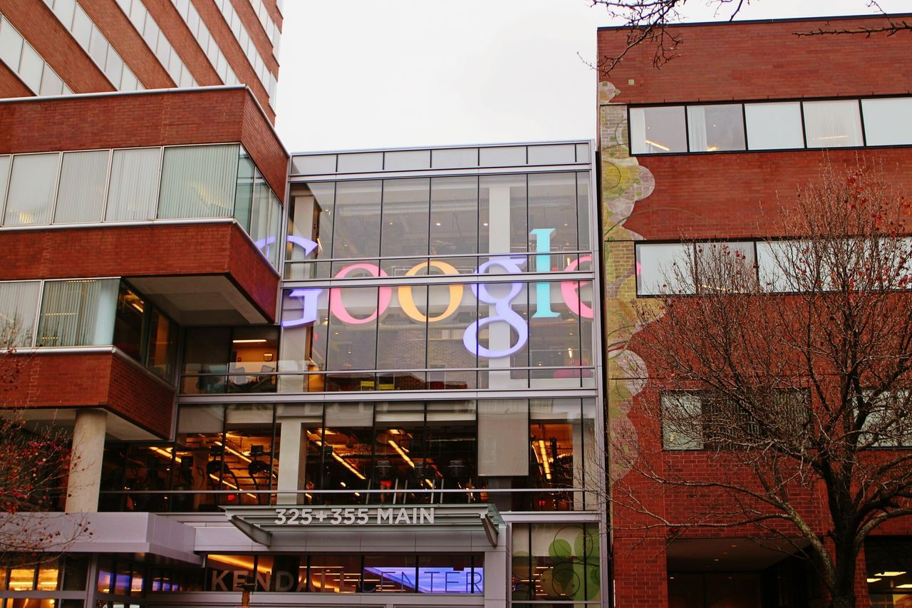 architecture, building exterior, built structure, text, day, outdoors, window, store, no people, multi colored, city