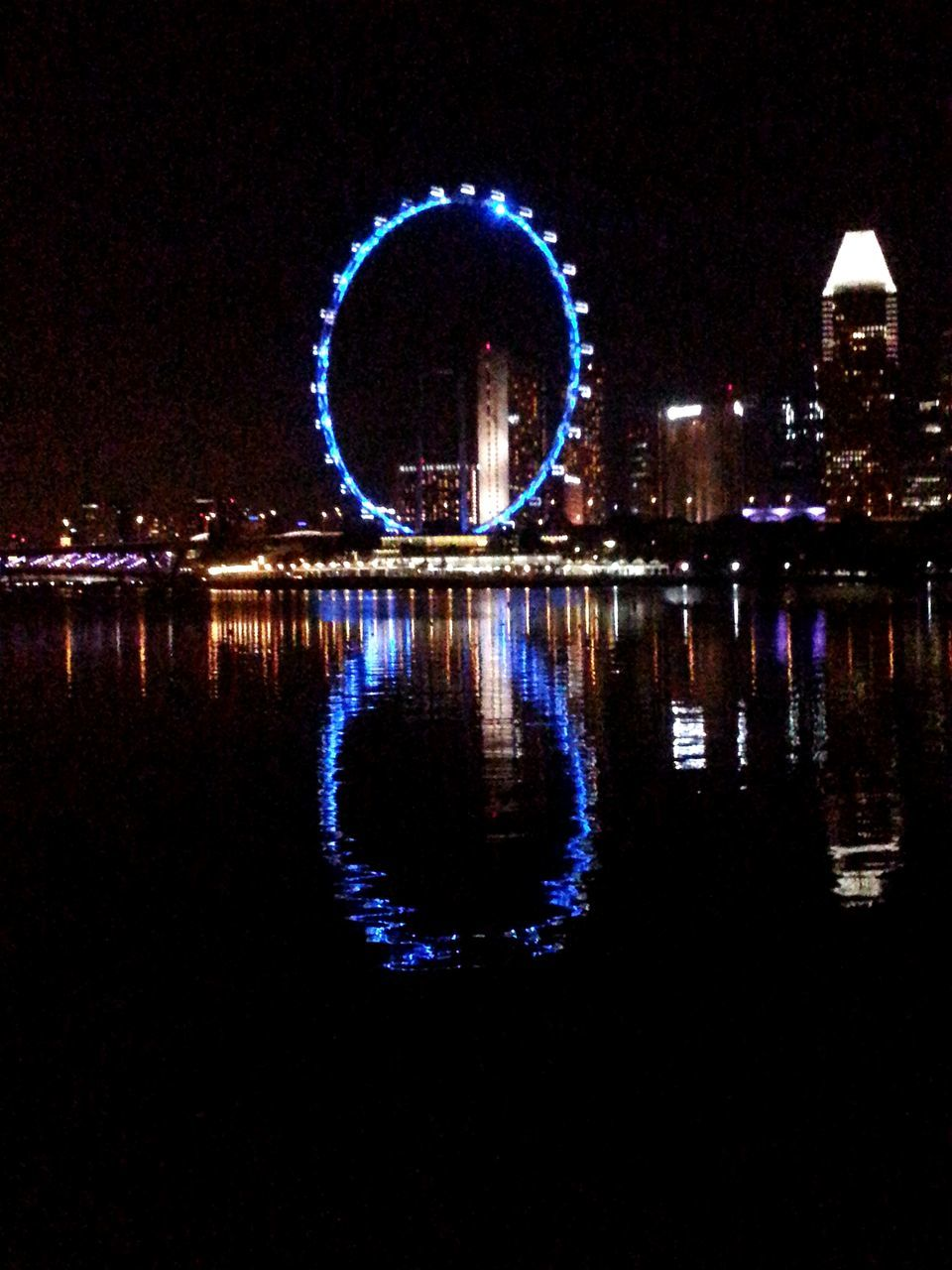 night, illuminated, reflection, arts culture and entertainment, water, no people, architecture, built structure, outdoors, sky, nature