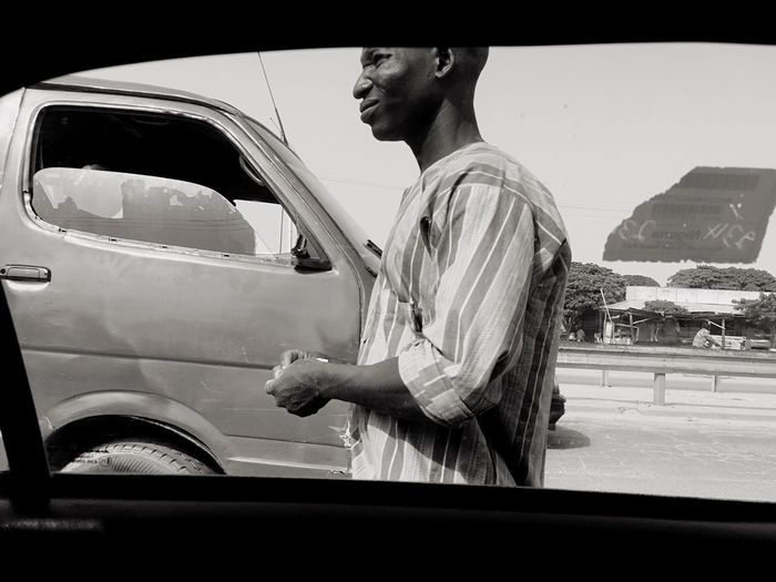 Real People Transportation One Person Men Car Land Vehicle Mode Of Transport Side View Young Adult Standing Day Outdoors Lifestyles Sky One Man Only Human Hand Adult Adults Only People First Eyeem Photo