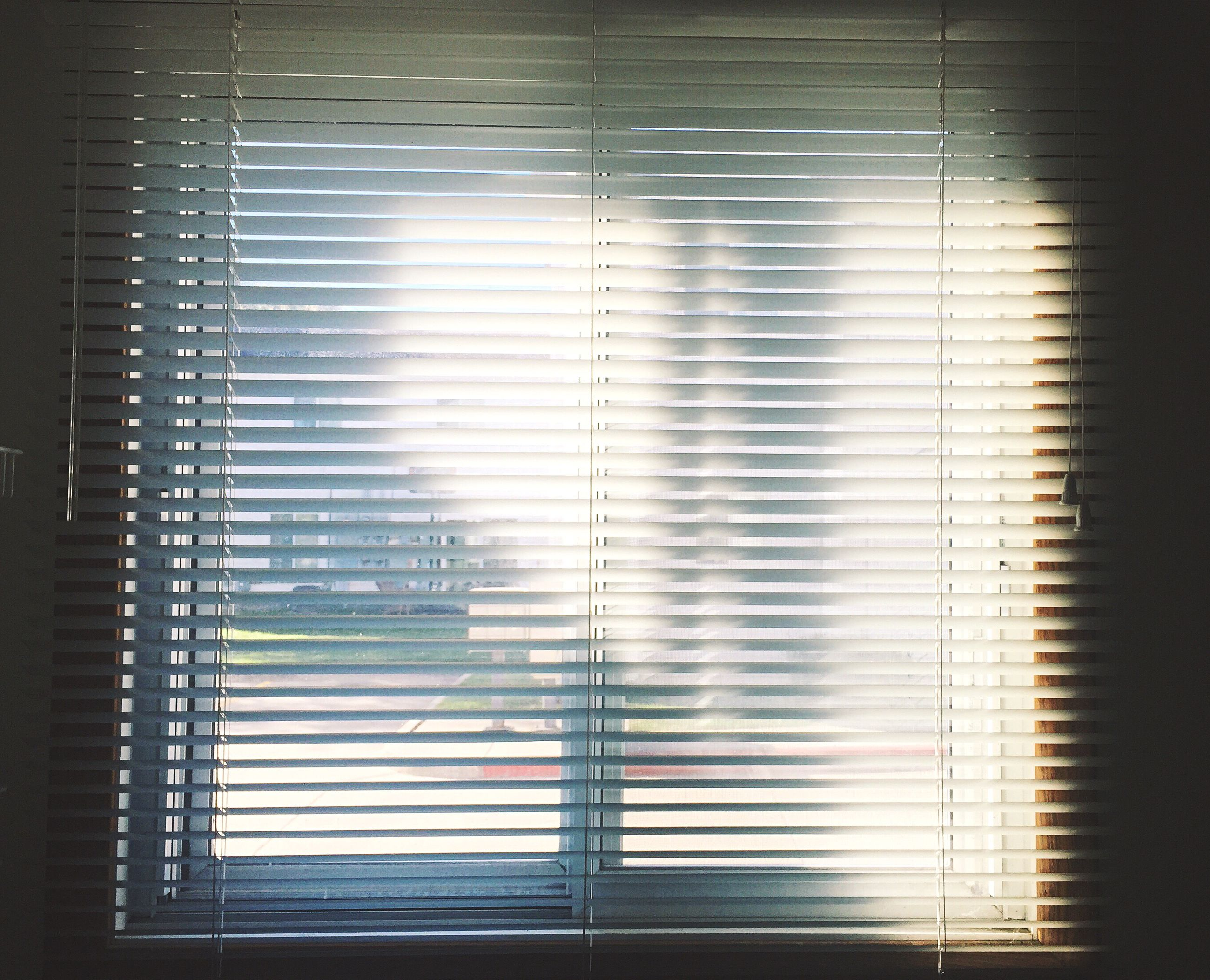 indoors, window, wall - building feature, blinds, curtain, pattern, closed, built structure, wall, architecture, full frame, home interior, backgrounds, glass - material, close-up, no people, shadow, house, sunlight, reflection