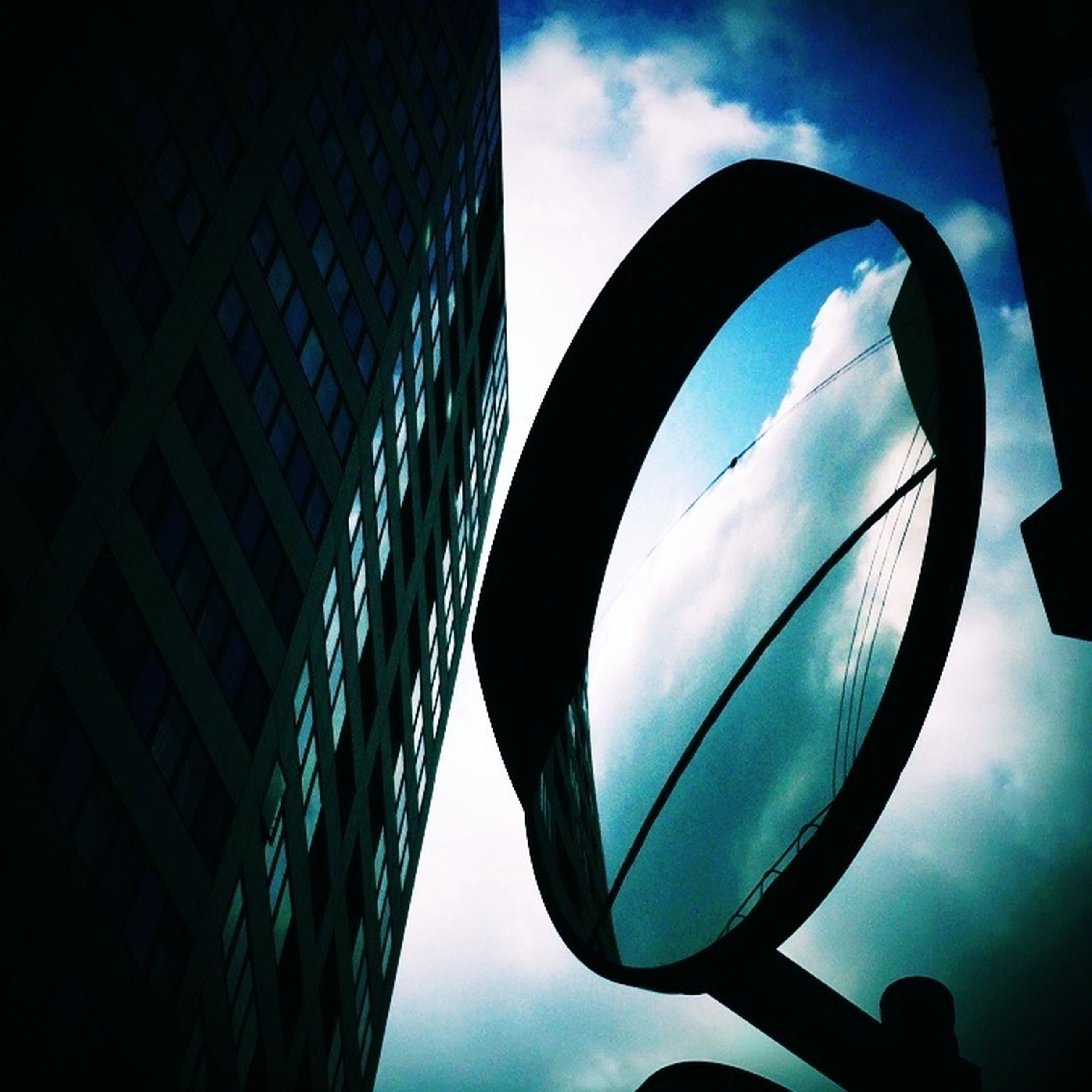 architecture, sky, built structure, building exterior, low angle view, window, reflection, cloud - sky, cloud, glass - material, building, city, modern, day, circle, no people, outdoors, transparent, blue, office building
