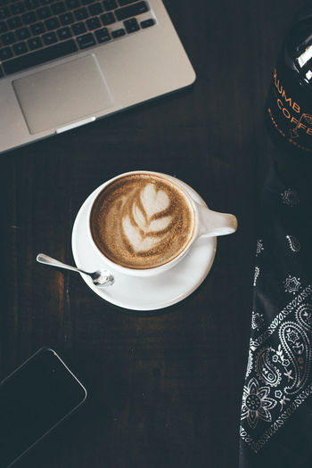 Coffee - Drink Coffee Cup Drink Food And Drink Frothy Drink Refreshment Table Cappuccino High Angle View Indoors  Latte No People Coffee Break Directly Above Saucer Wireless Technology Froth Art Close-up Freshness Day BestofEyeEm Refreshment Food Ready-to-eat Indulgence