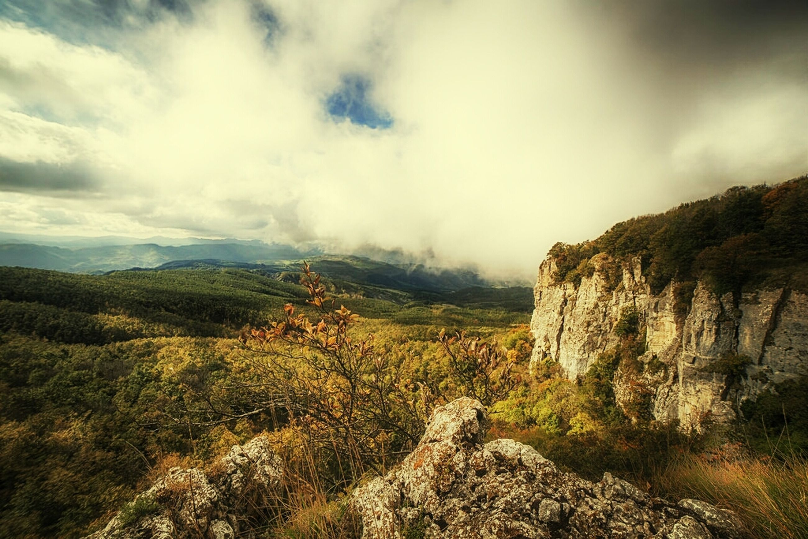 sky, tranquil scene, tranquility, scenics, beauty in nature, cloud - sky, landscape, nature, mountain, cloudy, non-urban scene, cloud, tree, growth, rock - object, rock formation, idyllic, day, remote, outdoors