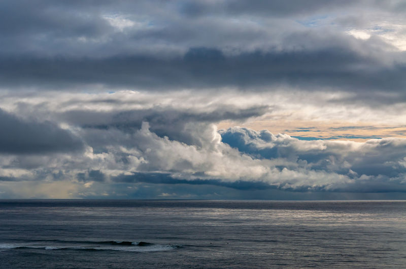 Sunset Cliffs Natural Park and Plant Preserve looking out over a dramatic stormy sky over the ocean. Cloud - Sky Sky Sea Horizon Over Water Beauty In Nature Scenics - Nature Horizon Water Tranquility Nature Tranquil Scene No People Storm Overcast Beach Outdoors Day Land Ominous Meteorology
