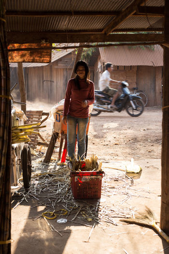 Cambodia Market Adult Basket Cambodian Culture Day Food Freshness Healthy Eating Indoors  Market Stall Marketplace One Person One Woman Only Only Women Outdoors People Real People Rustic Standing Sugarcane Transportation Women Working Young Adult