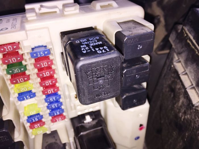 Car Parts Car Electronics Car Relay Box Car Trouble Relays And Switches Closeup FX 35 This is a close up shot of the hard to reach relay box of the 2007 Infinity FX35