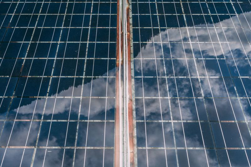 Full Frame Shot Of Solar Panels With Reflection