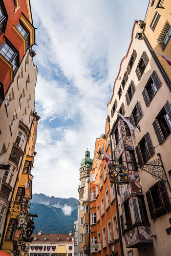 Low angle view of main street in old town of Innsbruck against mountains Austria Innsbruck Old Town Tirol  Travel Architecture Austrian Building Exterior Built Structure City Cloud - Sky Day Destination Europe Low Angle View Mountain Mountain Range No People Outdoors Sky Tyrol