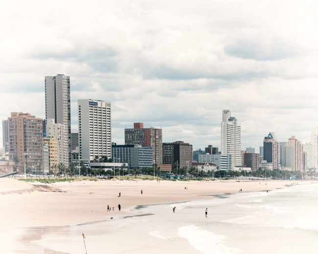 Durban beach Architecture Beach Photography City Beach Building Exterior Built Structure City Cityscape Cloud - Sky Colour Of Life Day Distant People Pastel Sand Sand & Sea Sea Sky Skyscraper