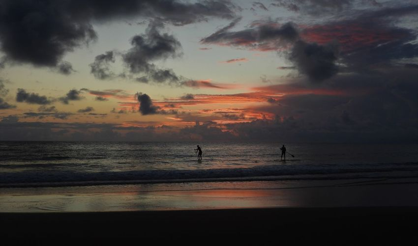 Stand Up Paddling Kellys Beach Bargara Sunrise Sky Cloud - Sky Water Sea Beauty In Nature Scenics - Nature Beach Silhouette Land Horizon Over Water Real People Horizon Group Of People Orange Color Tranquility Nature Tranquil Scene Lifestyles Outdoors