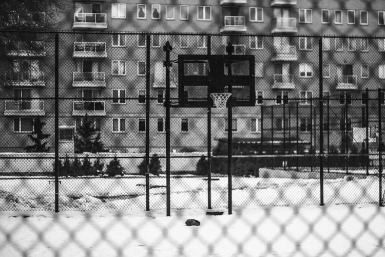 Basketball court against building