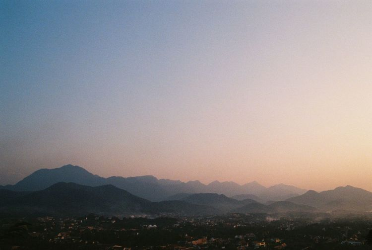 Mountain Sky Scenics - Nature Beauty In Nature Mountain Range Tranquility Copy Space Nature No People Outdoors Film Film Photography Filmisnotdead Tranquil Scene Landscape Clear Sky Environment Sunset Idyllic Non-urban Scene Silhouette Orange Color Sun Mountain Peak