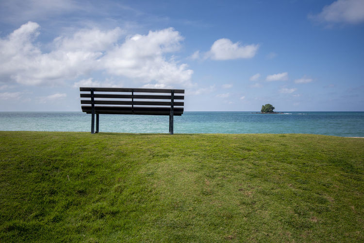 Bench Sky Water Sea Bench Grass Cloud - Sky Tranquil Scene Scenics - Nature Tranquility Beauty In Nature Seat Nature Horizon Horizon Over Water Land Plant Day No People Empty Outdoors Park Bench