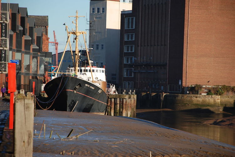 River Hull & river Humber meet Anchored Boat Arctic Ranger Museum River Hull Architecture Building Exterior Built Structure City Day Moored Mudbanks Nautical Vessel No People Outdoors Riverscape Water