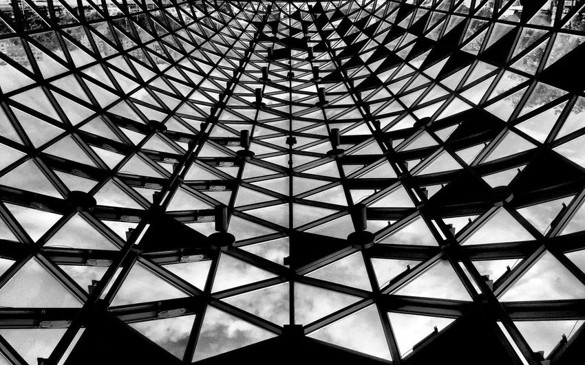 Low angle view of sky seen through modern building