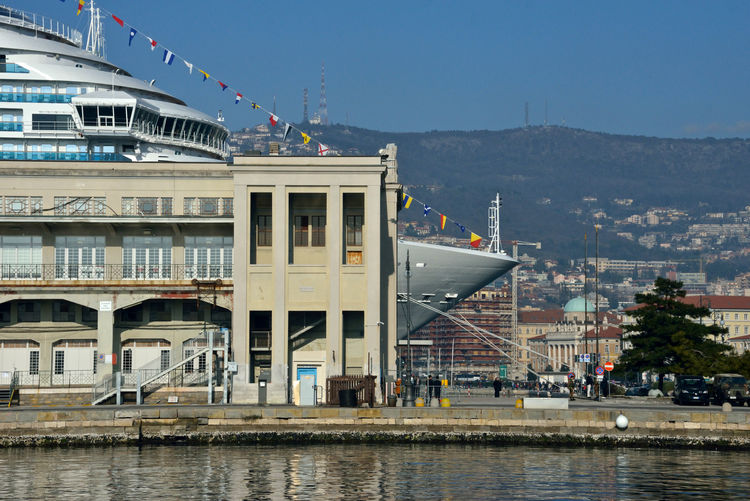 view of Costa Venezia behind a building of Trieste Cruise Terminal Trieste Maritime Station Costa Crociere Costa Venezia Cruise Ship Lifestyles Building Exterior Sea Architecture Waterfront Built Structure Transportation Mode Of Transportation Travel Destinations Outdoors Connection Terminal Cruise Cruise Terminal Water City Nature Travel