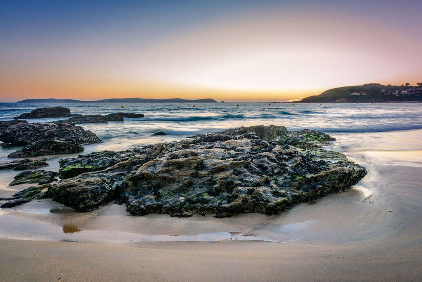 Rocks on the sand in the Rias Baixas, Galicia Beach Beauty In Nature Coastline Galicia Horizon Over Water Idyllic Montalvo Ocean Orange Color Outdoors Pontevedra Rias Baixas Rock - Object Sea Shore Sky SPAIN Sunset Tranquil Scene