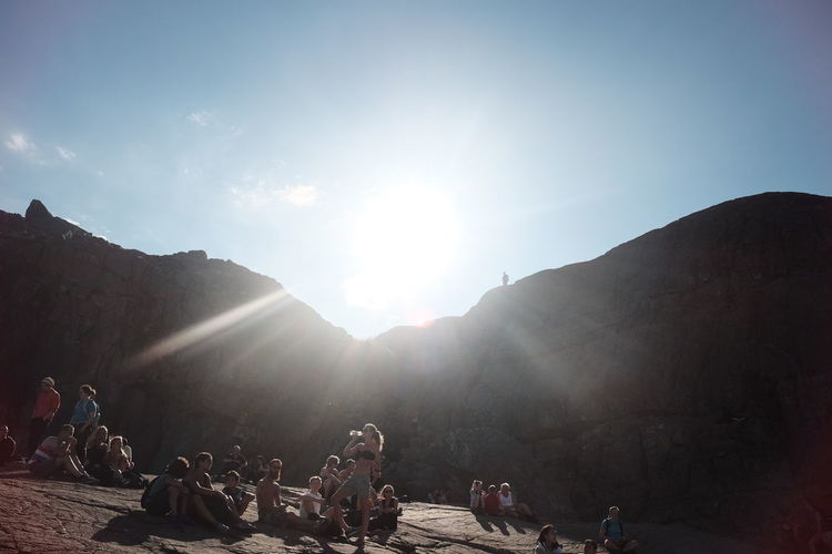 Adult Adventure Beauty In Nature Clear Sky Day Large Group Of People Leisure Activity Lens Flare Lifestyles Live For The Story Men Mountain Nature Outdoors People Real People Sitting Sky Sun Sunbeam Sunlight Tranquility Women