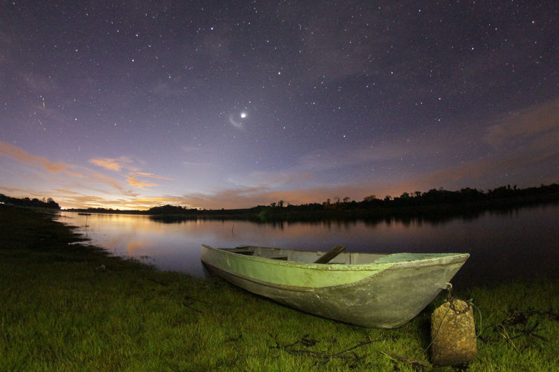 Astronomy Beauty In Nature Lake Landscape Nature Nautical Vessel Night No People Outdoors Reflection Space Star Field Water