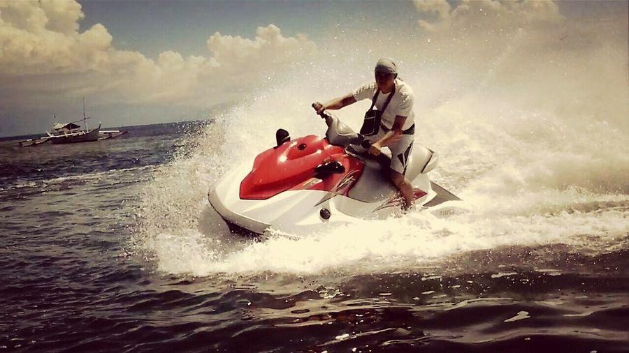 i really love doing this. jetskiing at Playa Calatagan Travelling