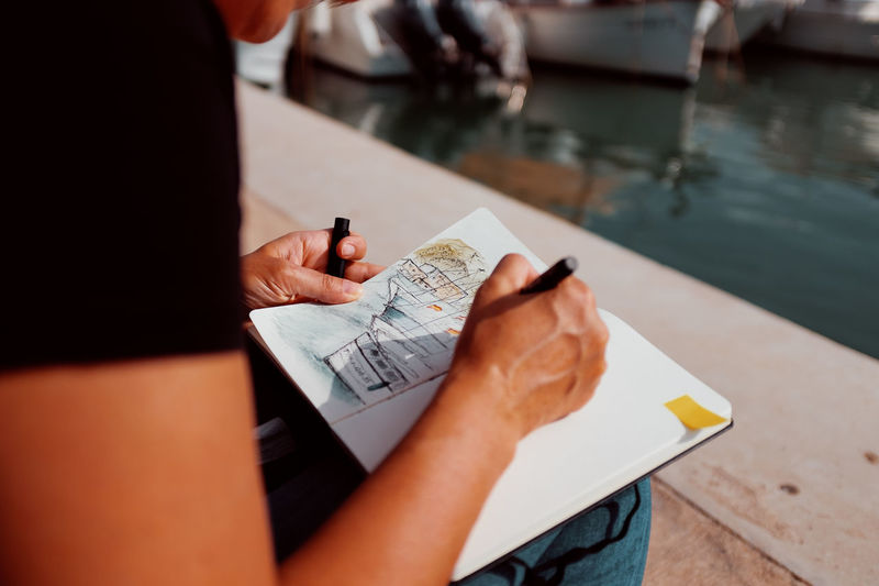 Fourdayspalma Holding One Person Human Hand Real People Hand Table Midsection Lifestyles Human Body Part Men Finance Selective Focus Business Indoors  Sitting Leisure Activity High Angle View Day Communication Sketching Sketching Book