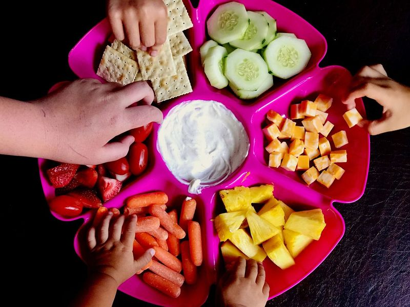 Dig In Kids Crackers Baby Carrots Cheese Boy Girls Baby Carrots Cucumber Pineapple Strawberries Slices Healthy Snacks Toddler  Teenager Children Human Hand Hand Food And Drink Food Human Body Part Healthy Eating Holding High Angle View Freshness Vegetable Indoors  Wellbeing Fruit SLICE Body Part Finger
