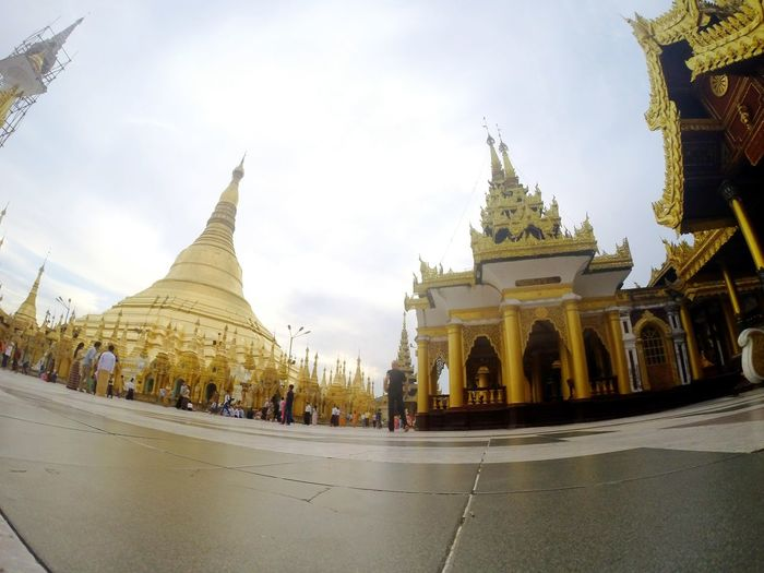 Architecture Gold Colored Gold Religion Sky Built Structure Arts Culture And Entertainment Place Of Worship Spirituality Myanmar Eyeem Myanmar Yangon Building Exterior Dome Cloud - Sky No People Outdoors Day